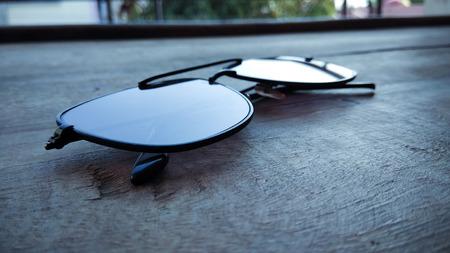 stylish eye goggles on wooden background.
