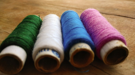 filament: Multicolor sewing threads on white background