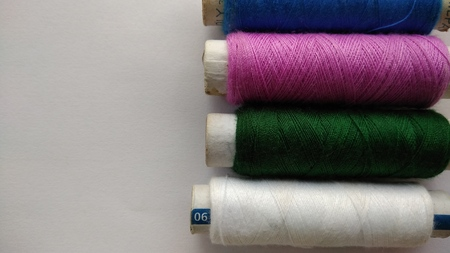 stitchwork: Multicolor sewing threads on white background