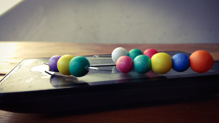 colorful bubbles on mobile phone with wood background