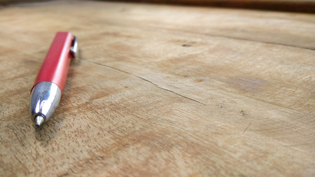 ballpen: stylish red pen on wood background