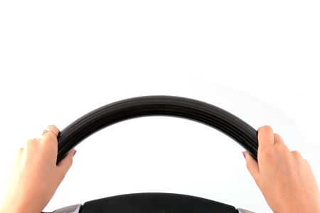 steering: Female hands on a steering wheel on the isolated white background