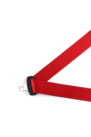 Red seat belt with a fastener isolated on the white background  photo