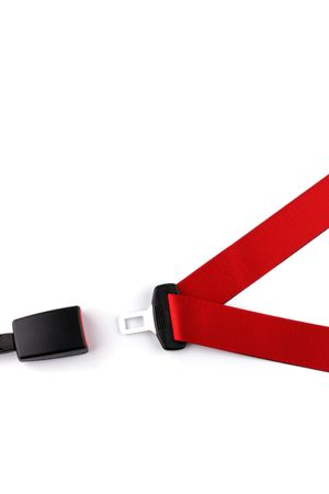 Red seat belt with a fastener and the lock isolated on the white background         photo