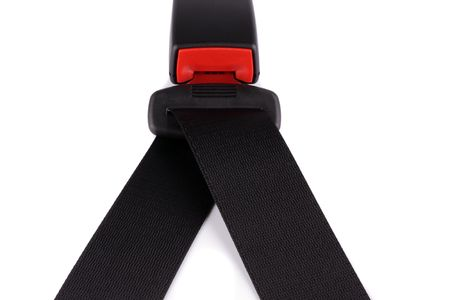 Black seat belt will clasp on the lock isolated on the white background    photo