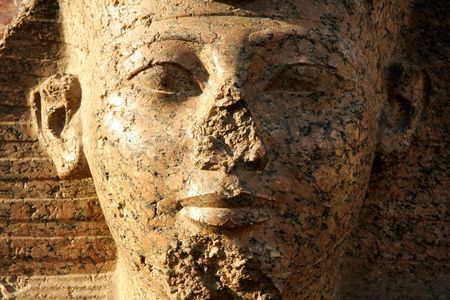 The person of the Egyptian sphinx. A fragment of a statue facing to an input in the Cairo museum photo