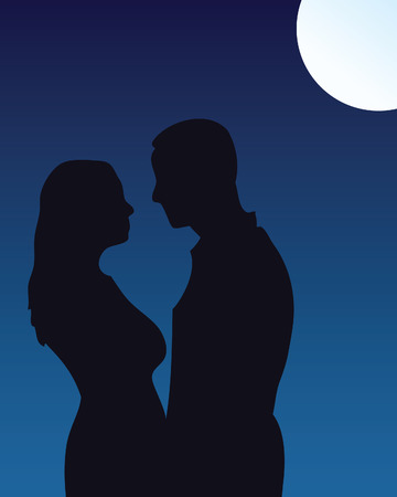 Silhouette of couple kissing under moonlight