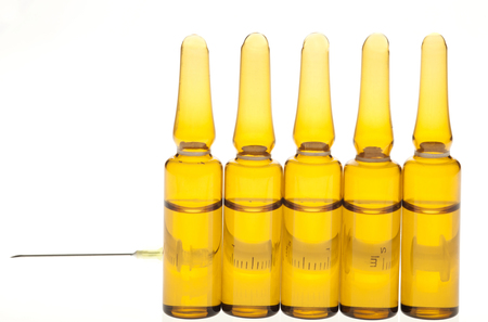 Ampoules and Syringe on a white background photo