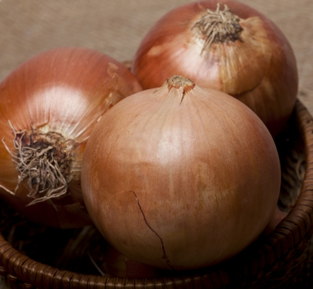 bisected: Group of onions in a wooden basket