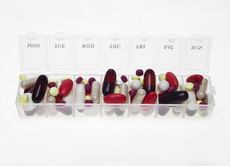 violet residential: Pill box with variety of pills and supplement