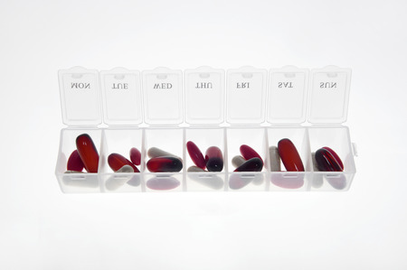 Pill box with variety of pills and supplement photo