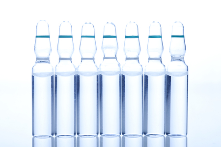 ampoules: Glass Medicine Ampoules with liquid on a white and blue background