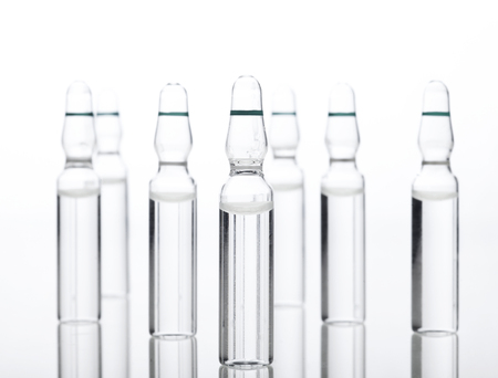 Glass Medicine Ampoules with liquid on a white background