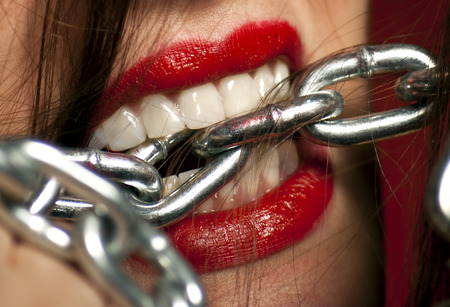 Close Up of Womans Mouth with Chains photo