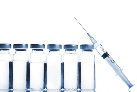 Glass Medicine Vials and botox, hualuronic, collagen or flu Syringe on a white background.