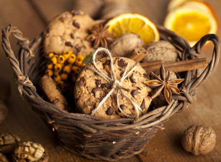 gift basket: Christmas cookies with spices and nuts on a wooden