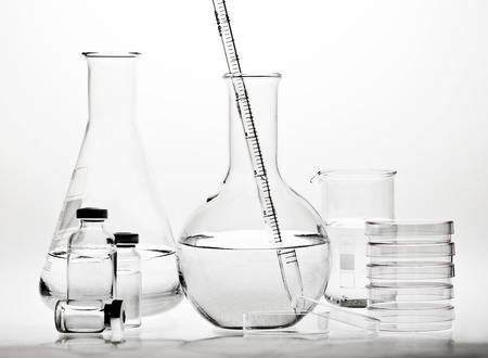 Test-tubes with reflections on a white background. Laboratory glassware. Stock Photo - 29162517