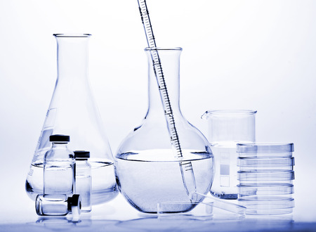 test tube: Test-tubes with reflections on a white and blue background. Laboratory glassware.