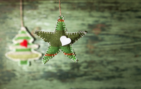 Handmade Christmas decoration over old wooden background. photo