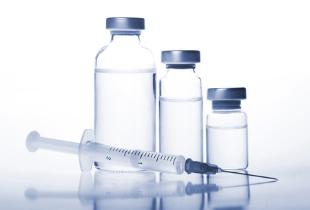 Glass Medicine Vials and hualuronic, collagen or flu Syringe. Tinted image.