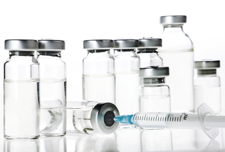Glass Medicine Vials and hualuronic collagen and flu syringe. Banque d'images