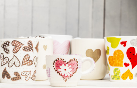 lots: Lots of coffee in different cups with hearts. Copy space.