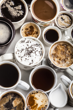 lots: Lots of coffee in different cups with hearts.