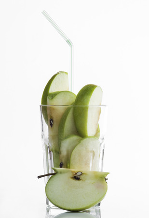 fresh apple fruits in a glass on a white background. photo
