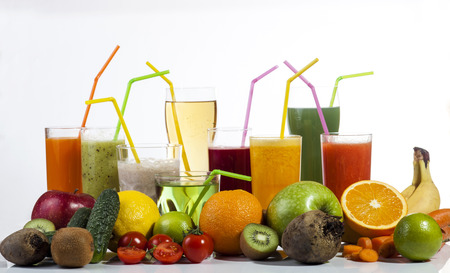Colorful fresh fruit and vegetable juices isolated on white background. photo