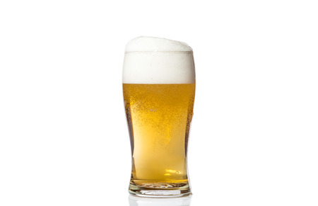 Glass of light beer isolated on white background. photo