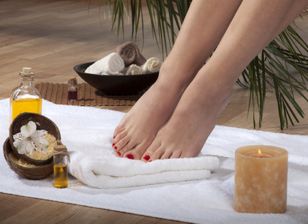 Female feet with drops of water on spa background. photo