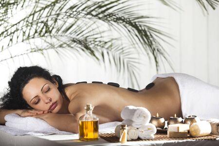 aroma therapy: Spa Stone Massage. Beautiful Woman Getting Spa Hot Stones Massage in Spa Salon.