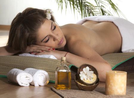 getting: Beautiful Woman Getting Spa Massage in Spa Salon.