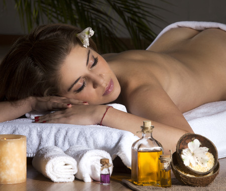 exfoliate: Beautiful Woman Getting Spa Massage in Spa Salon.