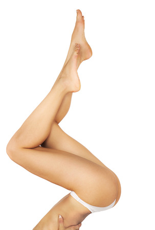 naked woman  white background: Perfect female legs isolated on white background. Stock Photo