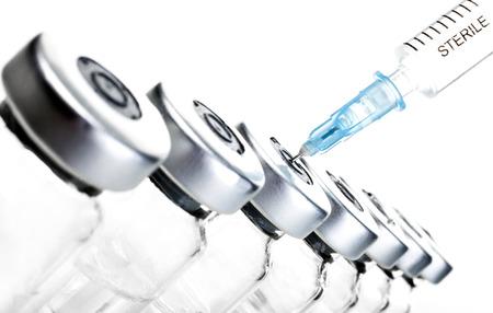 Glass Medicine Vials and hualuronic collagen or flu syringe. Standard-Bild