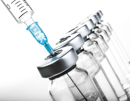 Glass Medicine Vials and hualuronic collagen or flu syringe. Stock Photo