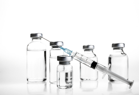 botox: Glass Medicine Vials and hualuronic collagen or flu syringe. Stock Photo