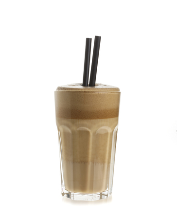 Glass of white coffee frappe isolated on white background Stock Photo