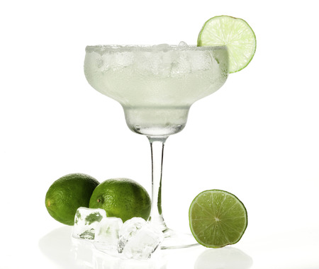 bartending: Glass of margarita cocktail on a white background.