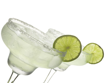 cocktail glasses: Two glasses of margarita cocktail on a white background.