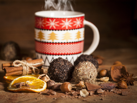 cafe bombon: Homemade cookies with Christmas cup on wooden background Foto de archivo