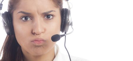 handsfree phones: Frustrated customer service operator on a white background Stock Photo