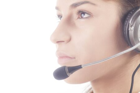 garniture: Portrait of cheerful support phone operator in headset, isolated on white background. Selective focus on the microphone. Stock Photo