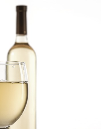 muscadet: Wineglass and bottle with white wine isolated on white background. Copy space.