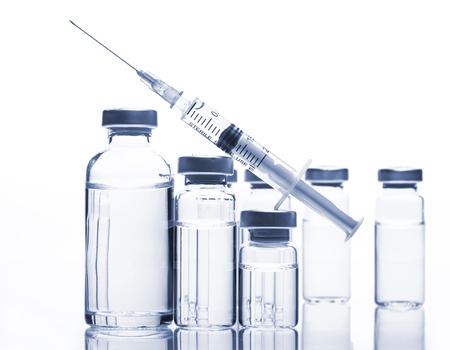 Glass Medicine Vials with botox, hyaluronic, collagen or flu syringe Stock fotó