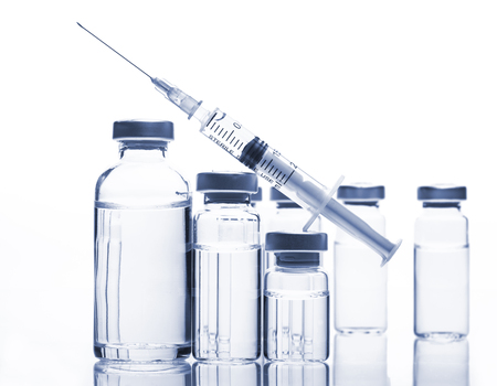 Glass Medicine Vials with botox, hyaluronic, collagen or flu syringe Banque d'images