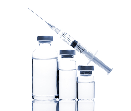 anesthetize: Glass Medicine Vials with botox, hyaluronic, collagen or flu syringe Stock Photo