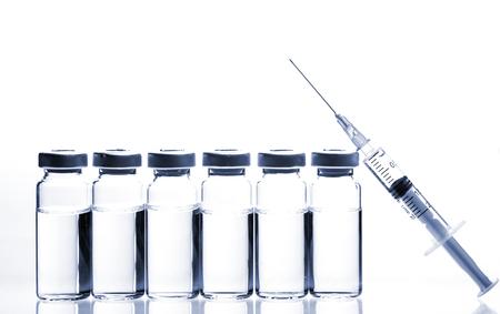 vials: Glass Medicine Vials with botox, hyaluronic, collagen or flu syringe Stock Photo