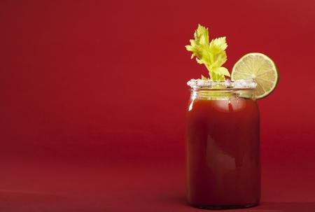bloody mary cocktail: Bloody Mary cocktail on a red background